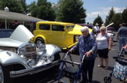 Seniors and family at classic car show