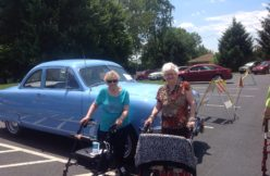 Seniors at a classic car show